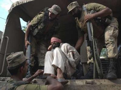 Pak Army unloads Taliban POWs.